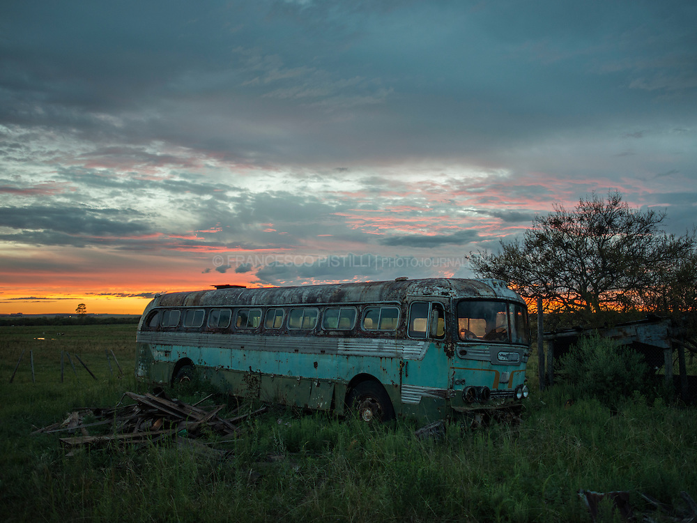 An abandoned bus alongside Ruta 5 that connecting Tacuarembo with Montevideo, passing through the centre of the country. It is a national route, one of the most important highways for the &quot;Meat Economy&quot; in Uruguay. <br /> Uruguay, Feb. 2014