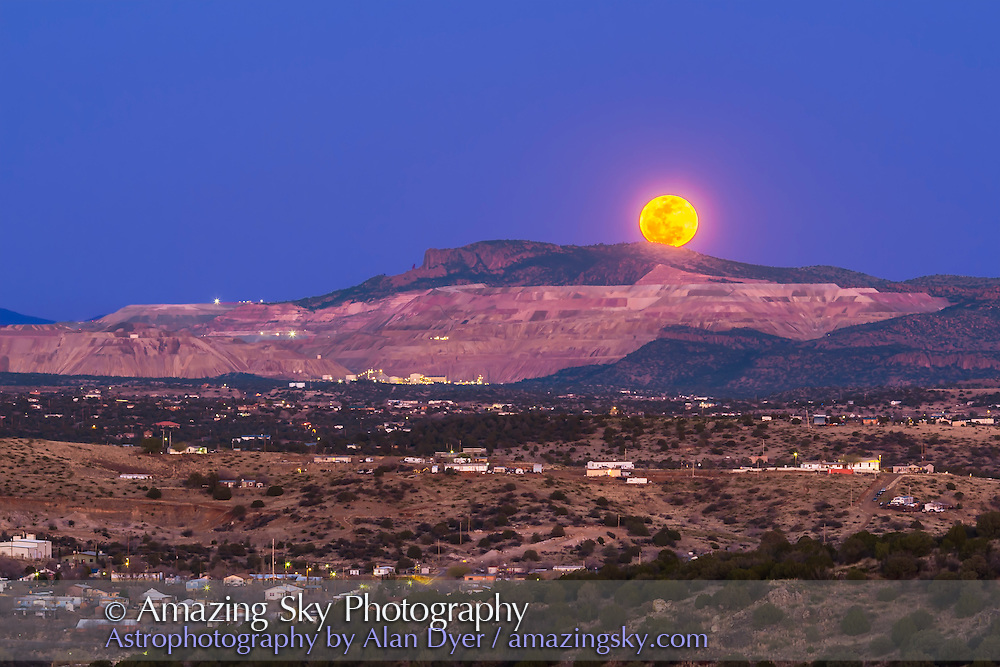 The March 5, 2015 &ldquo;mini-Moon&rdquo; rises over the Santa Rita Copper Mine, east of Silver City, New Mexico. This was the night of the farthest Full Moon of 2015, the apogee Moon. I caught the Moon as it was rising behind the Mine and the cliff formation known locally as the Kneeling Nun. <br /><br />This is a composite of a long 1-second exposure for the ground and sky and a short 1/13-second exposure for the Moon to preserve details in its disk, with the two exposures layered and masked in Photoshop. No colour alteration was applied to the Moon, though a Highlight recovery was applied to the Moon to bring out the dark mare areas. Both exposures at ISO 100 with the Canon 60Da and at 135mm lens at f/4.