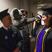 Spike offers celebratory high fives to Law School graduates. (Photo by Gonzaga University)