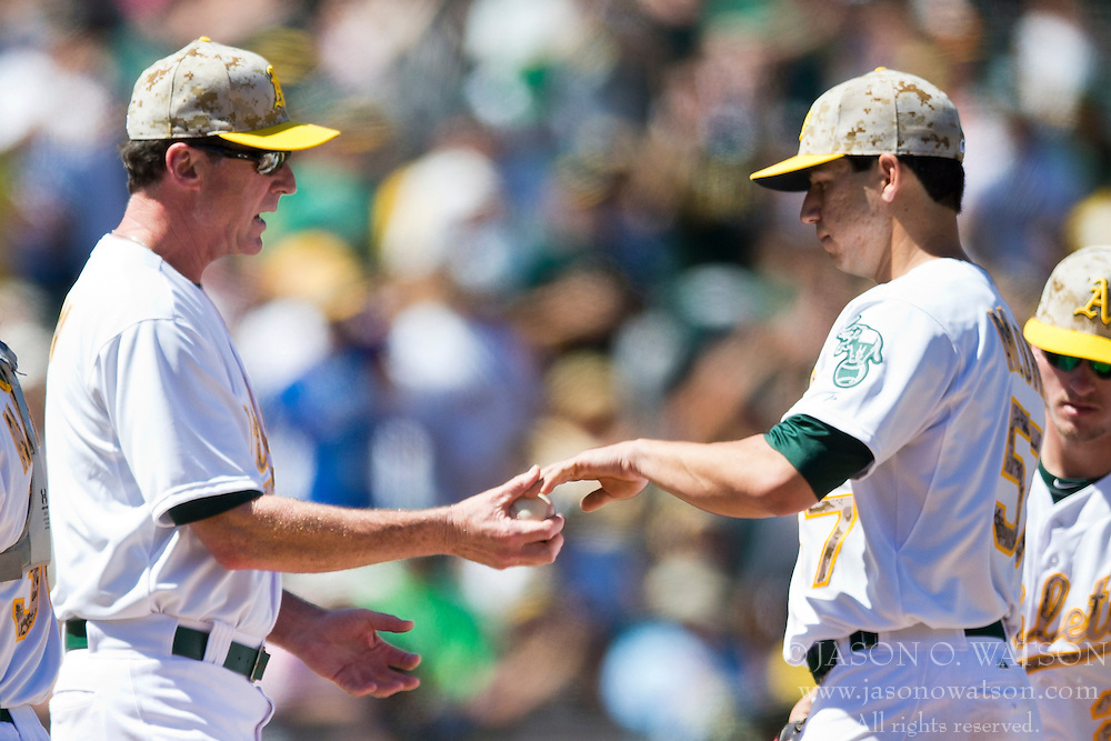 OAKLAND, CA - MAY 26:  Tommy Milone #57 of the Oakland Athletics is relieved by manager Bob Melvin #6 during the seventh inning against the Detroit Tigers at O.co Coliseum on May 26, 2014 in Oakland, California. (Photo by Jason O. Watson/Getty Images) *** Local Caption *** Tommy Milone; Bob Melvin