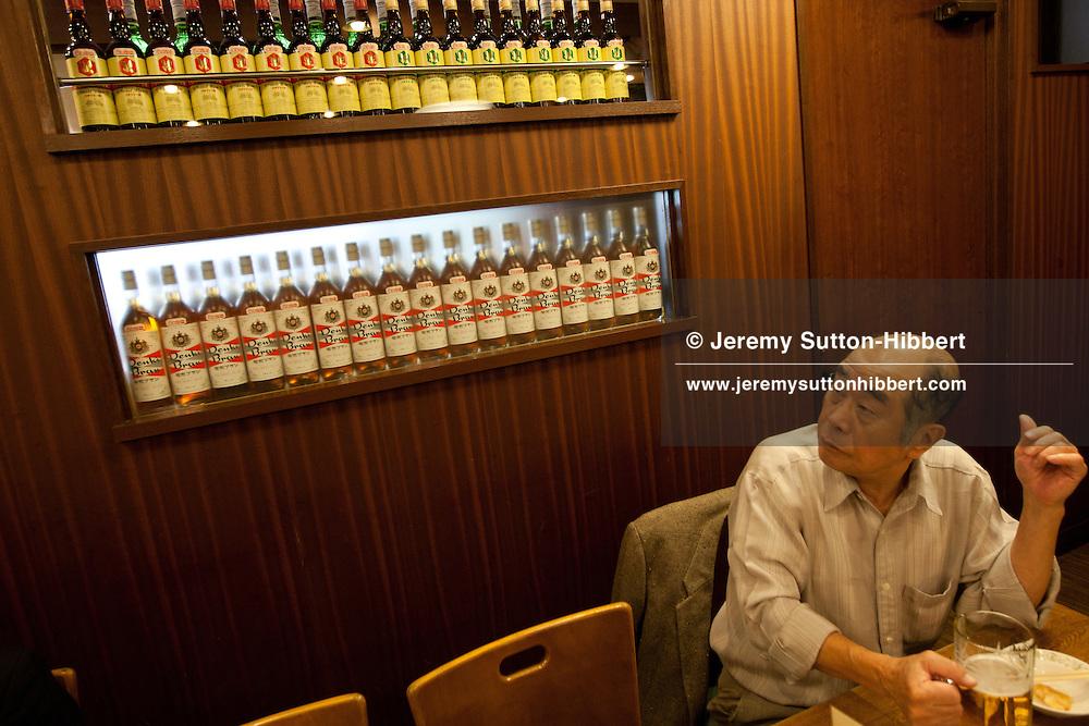 The Kamiya Bar, and glasses of beer and DenkiBran,  in Asakusa district of Tokyo, Japan, Monday 7th November 2011.