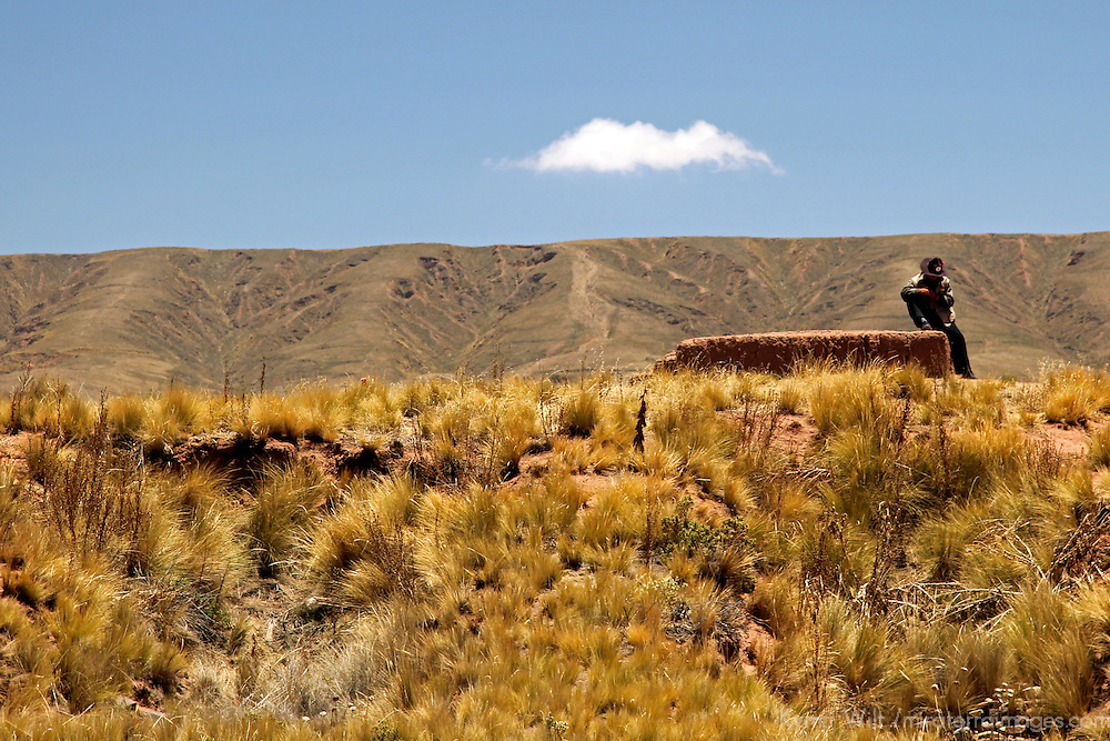 South America, Bolivia, Tiwanaku. Bolivian landscape and man near Tiwanaku.