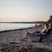 CAPE CHARLES, VA - JUNE 20: Dan Miller, right, and Brianne Van Doren, both of Danielsville, Penn., enjoy the sunset at Sunset Beach on Friday, June 20th, 2014 near Cape Charles, Va. The couple is traveling to the Outer Banks of North Carolina to celebrate their engagement and stopped for the evening in Cape Charles. (Photo by Jay Westcott/For The Washington Post)