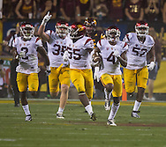 Arizona State University and University of Southern California in a football game on September 26, 2015 in Tempe, AZ.  USC won 42 to 14.  At half, USC led 35 to 0.<br /> <br /> USC defensive players Keith Hayward (3), Cameron Smith (35), Lamar Dawson (55), Chris Hawkins (4), Delvon Simmons (52) seize the spotlight in the last seconds of the first half with a fumble recovery deep in ASU territory that ended in a USC touchdown.