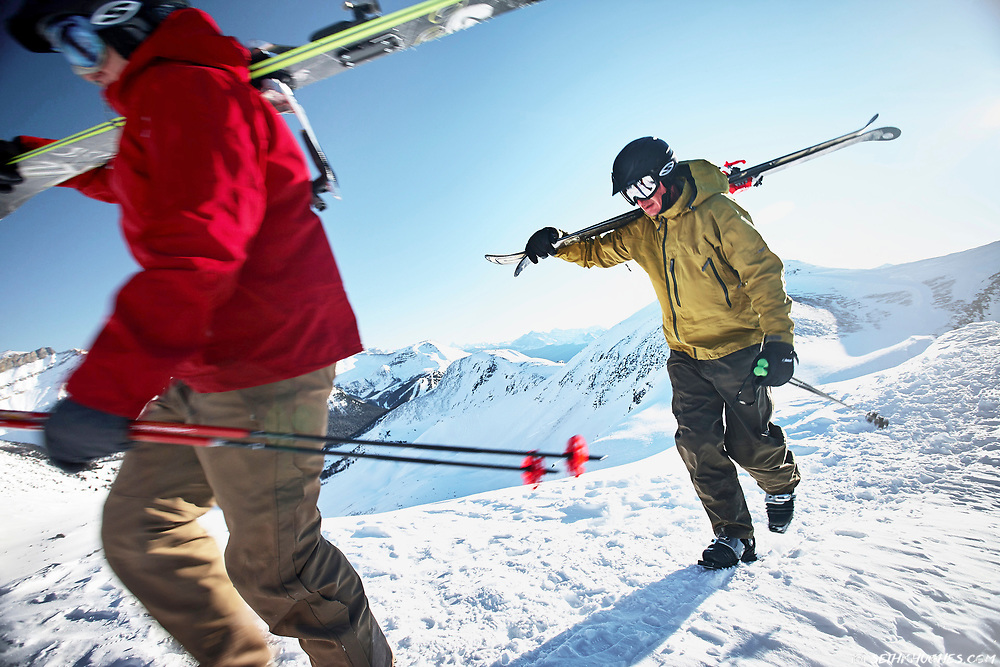 Skiers hike for backcountry access at the summit of Lake Louise Ski Resort in Alberta, Canada.
