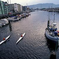 Europe, Norway. Sea kayakers along the Nidelva River in Trondheim.