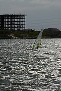 Wind Surfer enjoys a windy afternoon on the man-made Tempe Town Lake in Tempe, AZ.