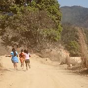 """Girls run away in the entrance of the town El ParaÌso, in Ayutla de los Libres, a na¥savi (mixteco) indigenous community. El ParaÌso is the newest headquarter of the Community Police (founded in 2012) and its the main flashpoint with other armed groups such as the self-called """"Autodefensas"""" (Self-Defenses) and paramilitary groups. / NiÒas corren en la entrada del pueblo El ParaÌso, en Ayutla de los Libres, comunidad indÌgena na'savi o mixteco. El ParaÌso es la sede m·s reciente de la PolicÌa Comunitaria (fundado en 2012) y es el principal lugar de confrontaciÛn con otros grupos armados como los conocidos como Autodefensas y grupos paramilitares.  (Photo: Prometeo Lucero)"""
