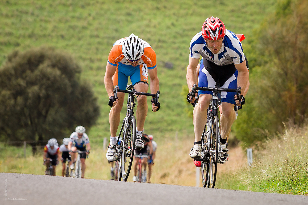 "Veteran cyclists riding uphill to finish of ""Red Rock Classic"" race"
