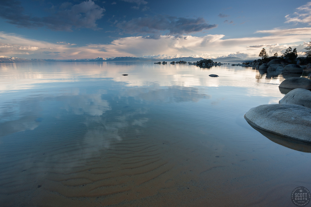 """Lake Tahoe 15"" - This photograph of clouds reflecting on the surface of Lake Tahoe and the sandy bottom were photographed in the evening at Speedboat Beach."