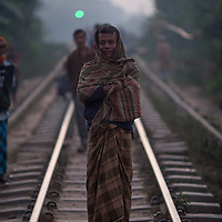 A man stands on the railway track at dusk in Srimongol in the tea growing region of north east Bangladesh. Many people walk and live on and around railway tracks all over Bangladesh