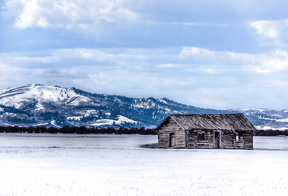 A lonely pioneer cabin in the winter of its life