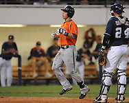 Auburn's Brian Fletcher hits a solo home run against Mississippi during a college baseball in Oxford, Miss. on Friday, May 21, 2010. (AP Photo/Oxford Eagle, Bruce Newman)