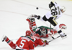 Mar 17; Newark, NJ, USA; New Jersey Devils goalie Martin Brodeur (30) makes a save on Pittsburgh Penguins left wing Steve Sullivan (26) during the third period at the Prudential Center. The Penguins defeated the Devils 5-2.