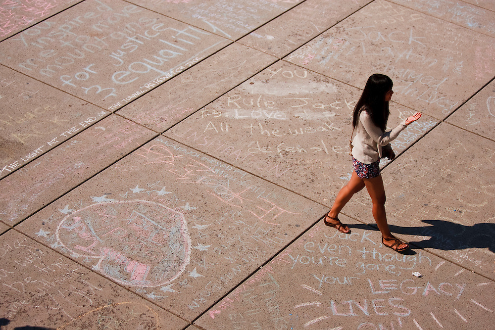 Toronto, Ontario ---11-08-27--- Thousands of people have written their memories of the late NDP leader Jack Layton in chalk on the sidewalks at City Hall in Toronto, Ontario. The leader of the opposition will be memorialized in a state funeral at Roy Thompson Hall August 27, 2011.<br /> AFP/GEOFF ROBINS/STR