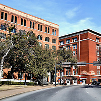 Texas School Book Depository Building Facing Dealey Plaza in Dallas, Texas<br /> On November 22, 1963, John F. Kennedy&rsquo;s limousine drove slowly down Elm Street in Dealey Plaza. At 12:30 P.M., an Italian Carcano, bolt-action rifle emerged from the sixth-floor window (upper right corner) of the Texas School Book Depository Building on the left. Shots were fired. The bullets wounded Governor Connally and killed the 35th President of the United States. The photo is taken from the spot of the first impact.
