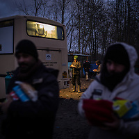 Migrants are seen after a good distribution in the Dunkerque camp, France. FEDERICO SCOPPA/CAPTA