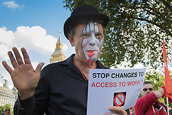 Deaf and disabled people march in Westminster against Department of Work and Pensions cuts that impact on the equality between able and disabled people's opportunities to pursue careers.