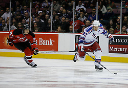 Feb 20, 2007; East Rutherford, NJ, USA; New York Rangers center Michael Nylander (92) skates past New Jersey Devils forward Barry Tallackson (27) during the third period at Continental Airlines Arena in East Rutherford, NJ.