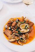 Porco À Alentejana (braised pork and clams) at Tasquinha do Oliveira restaurant in Évora, Alentejo