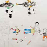 """""""Two planes drop bombs on the people. The children are crying, and the father has lost his hands."""" Drawing by Syrian girl, age 13. (Topic for this session: dealing with loss.) (Note: Arabic writing removed from top-right of image)"""
