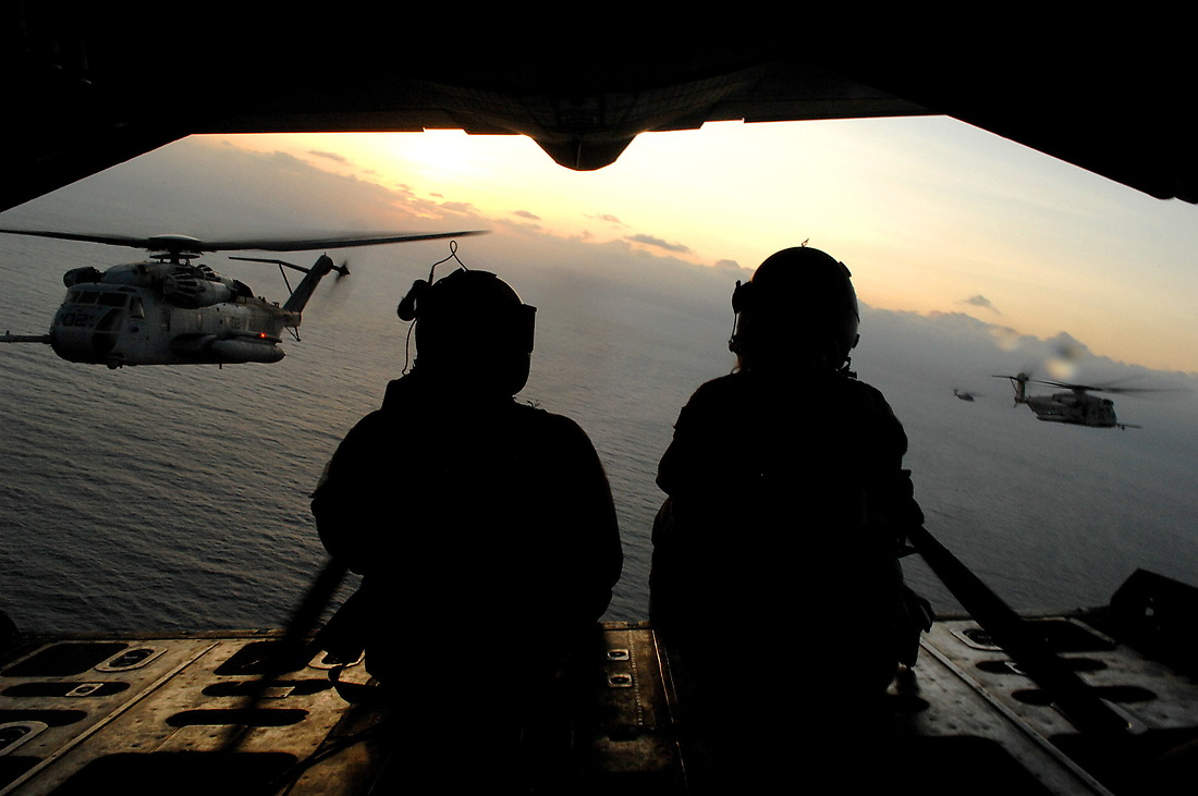 HC-130 Loadmasters SrA Daniel Sullivan and SrA Renea Zachary from the 71st Expeditionary Search and Rescue Squadron, Moody AFB, Georgia, communicate with the CH-53 helicopters from the Marine Heavy Helo Squadron 464, Marine Corps Air Station, Jacksonville, North Carolina, during in air refueling on January 19, 2008, while deployed to the Combined Joint Task Force - Horn of Africa, located at Camp Lemonier, Djibouti, Africa. — © TSgt. Jeremy T. Lock/