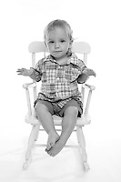 21 July 2008:  One year old toddler Jonah Wells in the studio on white seamless paper silo.  Black and White monochrome photo image.