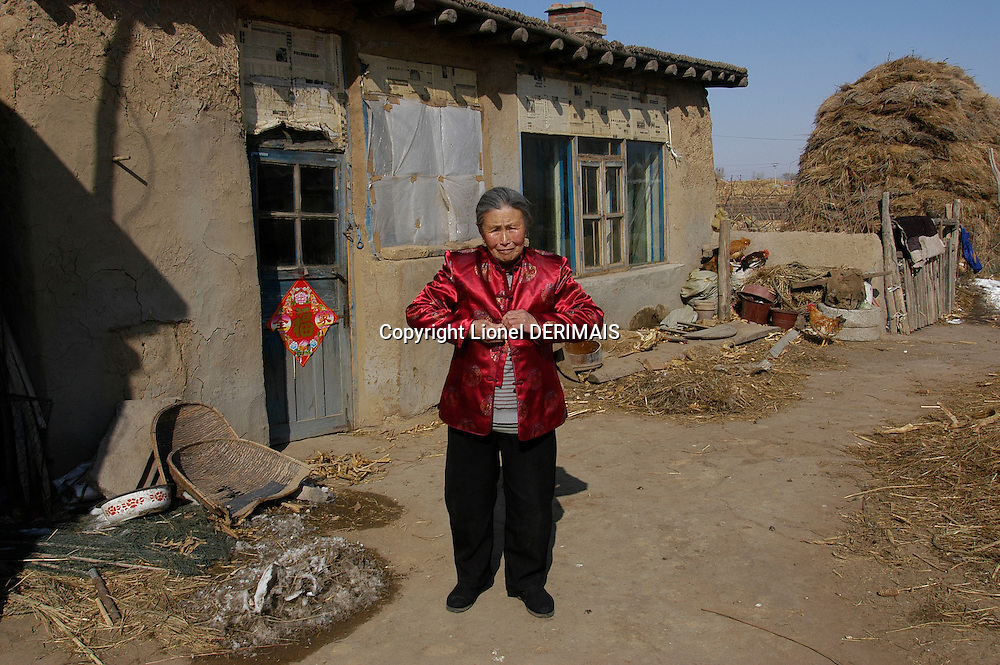 Meng Shujing (82) at home in Sanjiazi near the town of Qiqihar in Heilongjiang province in North-east China photographed on March 3rd 2007..She is among the last Manchu speakers (less than 100 in the world).