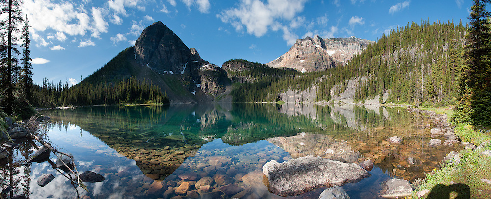Egypt Lake reflects peaks in Banff National Park, Alberta, Canada. This is part of the big Canadian Rocky Mountain Parks World Heritage Site declared by UNESCO in 1984. Panorama stitched from 8 images.