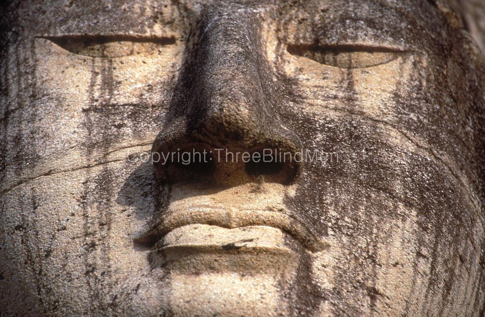 Sri Lanka..Detail of face of the standing figure of the Buddha, Gal Vihara,.Polonnaruwa.