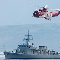 Irish Coast Guard S-61 and Irish Navy ship the LE Ciara at the Salthill Airshow 2007.<br />