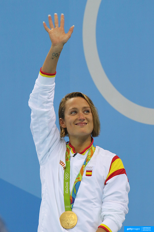 Swimming - Olympics: Day 5  Mireia Belmont Garcia of Spain with her gold medal after winning the Women's 200m Butterfly Final during the swimming competition at the Olympic Aquatics Stadium August 10, 2016 in Rio de Janeiro, Brazil. (Photo by Tim Clayton/Corbis via Getty Images)