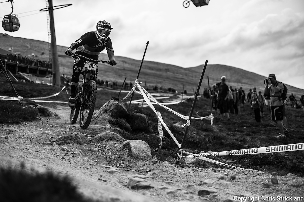 Nevis Range, Fort William, Scotland, UK. 4th June 2016. Crowds line the 2.8km course as elite riders qualify. Michelle crisp of Australia in action. The worlds leading mountain bikers descend on Fort William for the UCI World Cup on Nevis Range.