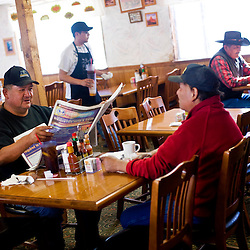 Local coal miners Robert Peaches Jr. and his brother Darryl eat a meal at the Anasazi Inn before heading in for their shift at the Kayenta Mine.