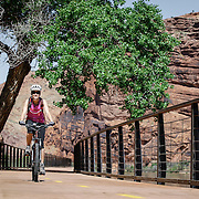 SHOT 5/9/16 9:43:36 AM - Moab is a city in Grand County, in eastern Utah, in the western United States. Moab attracts a large number of tourists every year, mostly visitors to the nearby Arches and Canyonlands National Parks. The town is a popular base for mountain bikers and motorized offload enthusiasts who ride the extensive network of trails in the area. Includes images of Scenic Byway 128, Fisher Towers and downtown Moab. (Photo by Marc Piscotty / © 2016)