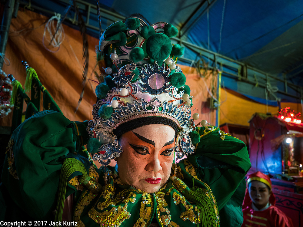 04 FEBRUARY 2017 - BANGKOK, THAILAND:  A performer puts on his costume before going on stage for the Lunar New Year at the Phek Leng Keng Shrine in the Khlong Toey section of Bangkok. Many Chinese shrines and temples host Chinese operas during the Lunar New Year. Lunar New Year was January 28 this year and opera troupes are finishing their holiday engagements at the local temples.    PHOTO BY JACK KURTZ