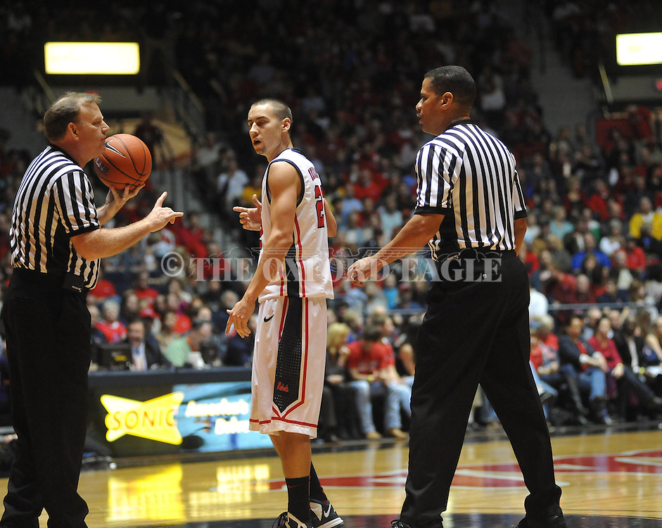 "Officials talk with Ole Miss' Marshall Henderson (22) vs. Missouri at the C.M. ""Tad"" Smith Coliseum on Saturday, January 12, 2013. Ole Miss defeated #10 ranked Missouri 64-49."