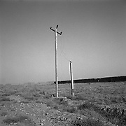 Power lines and poles that lead to the main building at Tarnak Farms, the al Qaeda base, training camp and pre 9/11 al Qaeda headquarters in Kandahar, Afghanistan which served as a home to Osama Bin Laden and numerous al Qaeda fighters located outside Kandahar City. It is believed that this base was where the plan for the 9/11 attacks originated, as a result Tarnak Farms was heavily bombed by the United States after September 11, 2001. (Credit Image: © Louie Palu/ZUMA Press).