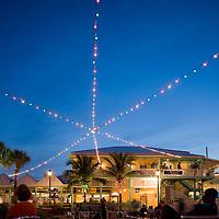 Bahamas, Grand Bahama Island, Freeport, Decorative lights above public square near waterfront restaurants near Our Lucaya Resort along Marina