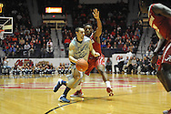 "Mississippi's Marshall Henderson (22) is defended by Alabama guard Retin Obasohan (32) at the C.M. ""Tad"" Smith Coliseum in Oxford, Miss. on Wednesday, February 26, 2014. (AP Photo/Oxford Eagle, Bruce Newman)"
