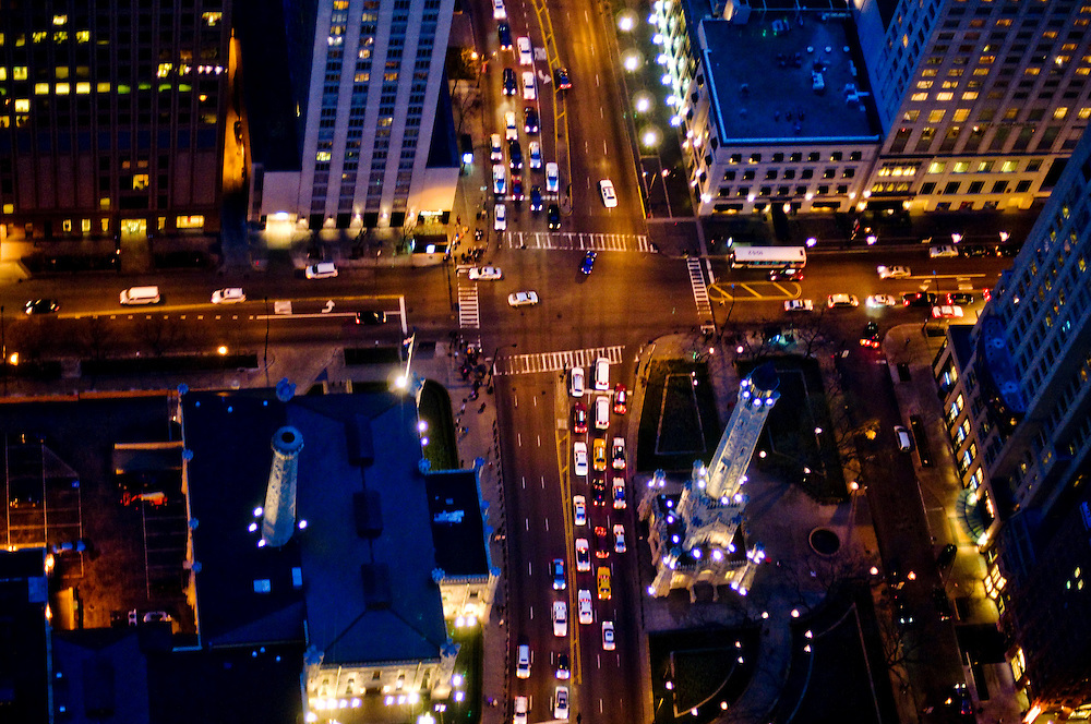 View down from the Hancock Building on the intersection of North Michigan and East Chicago Avenues, and the historic Chicago Water Tower.<br /> <br /> <br /> Green Chicago..Photographer: Chris Maluszynski /MOMENT