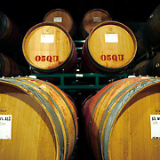 SHOT 3/1/2007-3/6/2007 - Oak barrels sit stacked in rows as wine ages inside each of them at a winery in Sonoma County, Ca. Winemaking, or vinification, is the process of wine production, from the selection of grapes to the bottling of finished wine. The secondary fermentation usually takes place in either large stainless steel vessels with a volume of several cubic meters of wine, or oak barrels, depending on the goals of the winemakers..(Photo by Marc Piscotty © 2007)