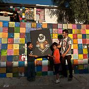 Efren De La Cruz, painter, at his apartment in Mexicali, Mexico.<br /> <br /> http://www.stefanfalke.com/<br /> &copy; Stefan Falke