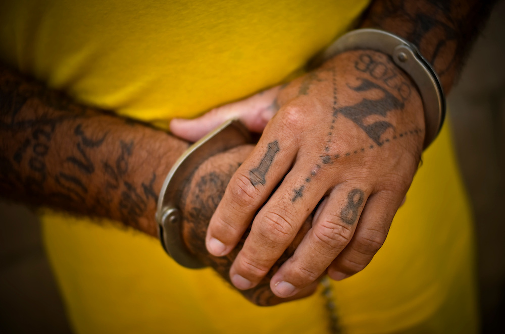 The handcuffed hands of a member of the Mara 18 gang incarcerated in Izalco men's prison in El Salvador.