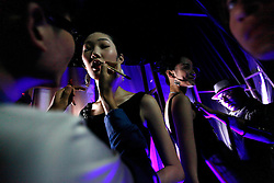 Models prepare backstage before the China Fashion Designer Top Award Winners Collection show during the China Fashion Week in Beijing, China, 31 October 2012. The Mercedes-Benz China Fashion Week will run from 24 October to 3 November.