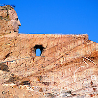 Crazy Horse Memorial in Custer County in Black Hills, South Dakota<br /> Some visions require persistence. The best example might be Crazy Horse Memorial in Custer County, South Dakota. The project was commissioned by Lakota Chief Henry Standing Bear. The sculptor, Korczak Ziolkowski, started carving the Indian warrior on a horse with an outstretched arm in 1948. Fifty years of hard work were needed to finish the face. After his death in 1982, his wife Ruth took control until she died in 2014. Now their children are heeding his advice of &ldquo;Go slowly so you get it right.&rdquo; There is no timeframe for completing this 560 foot monument in the Black Hills.