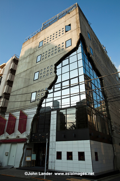 "East Gallery, despite its name, is a unique building in Ebisu, Shibuya-ku, Tokyo.  Often called the ""cracked building"" because of its facade, it houses several upscale restaurants within, and a wedding hall."