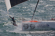 10th August 2011. Cowes. Isle of Wight..Pictures of Hugo Boss, skippered by British offshore racer Alex Thomson, with Ewan Mcgregor onboard, during The Artemis Challenge round the Island race...Aberdeen Asset Management Cowes Week 2011...Credit: Lloyd Images.