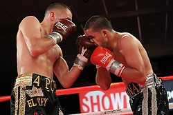 October 28, 2011; Atlantic City, NJ; USA; Javier Molina (black/silver) and Artemio Reyes (black/gold) during their 8 round bout on Shobox at Bally's in Atlantic City, NJ. Reyes won a unanimous decision.