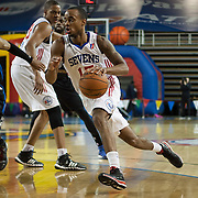 Delaware 87ers Guard Lorenzo Brown (17) drives towards the basket in the course of a NBA D-league regular season basketball game between the Delaware 87ers (76ers) and the Springfield Armor (Nets) Saturday, Dec. 28, 2013 at The Bob Carpenter Sports Convocation Center, Newark, DE